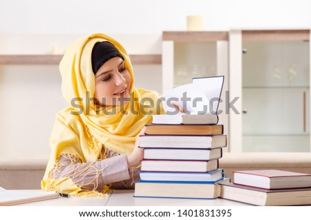Female student in hijab preparing for exams  #1401831395