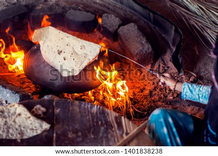 Arab woman makes bread in the beduin village in Egypt. #1401838238