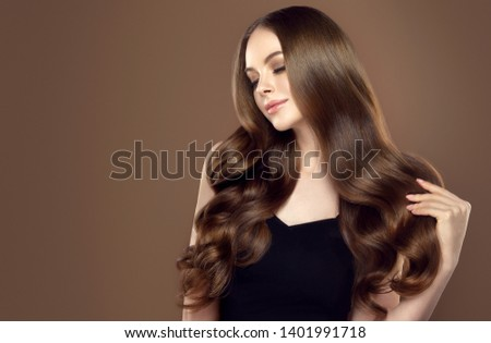 Beauty girl with long  and   shiny wavy hair .  Beautiful   woman model with curly hairstyle .  Royalty-Free Stock Photo #1401991718