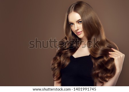 Beauty girl with long  and   shiny wavy hair .  Beautiful   woman model with curly hairstyle .  #1401991745