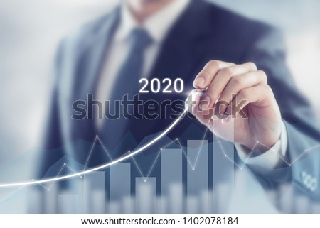 Growth success in 2020 concept. Businessman plan and increase of positive indicators in his business. #1402078184