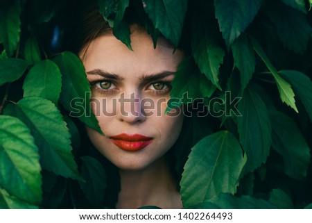 pretty woman with make-up on face red lips green shrub nature model fresh air #1402264493