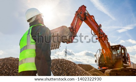 civil engineer worker on consstruction site with excavator machine #1402322930