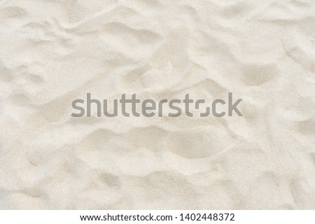 Full frame shot. Close up sand texture on beach in summer. Royalty-Free Stock Photo #1402448372