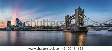 Panoramic view of the skyline of London, UK, during evening: from the Tower Bridge along the Thames river to the skyscrapers of the City #1402454618