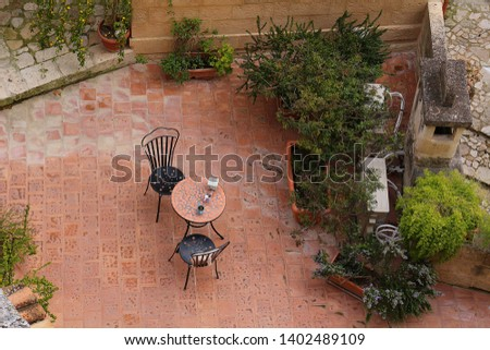 Cozy Mediterranean style patio with outdoor furniture and pot garden, topview