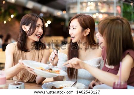 Group of Happy friends having dinner in the restaurant #1402543127