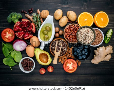 Ingredients for the healthy foods selection. The concept of healthy food set up on wooden background. #1402606916