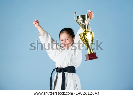 Karate fighter child. Karate sport concept. Self defence skills. Karate gives feeling of confidence. Strong and confident small kid. Victory and win. Girl little child in white kimono with belt. #1402612643