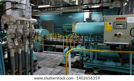 Cruise ship engine room interior with water tight doors electrical and diesel engines, water pipes, measuring instruments #1402656359