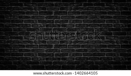 Black brick wall texture. Aged stone block masonry. Dark gloomy background #1402664105