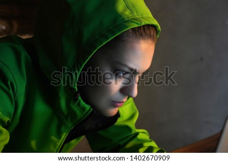 Young Female Hacker Breaks into Corporate Data Servers from His Underground Hideout. Place Has Dark Atmosphere - Image #1402670909