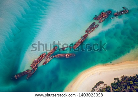 The Tangalooma Wrecks used to be 15 steam driven barges which were deliberately sunk in 1963 along the Moreton Island coastline to form a breakwall so that small boats can anchor in shelter. #1403023358