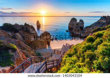 Camilo Beach (Praia do Camilo) at Algarve, Portugal with turquoise sea in background. Wooden footbridge to beach Praia do Camilo, Portugal. Wonderful view of Camilo Beach in Lagos, Algarve, Portugal. #1403043104