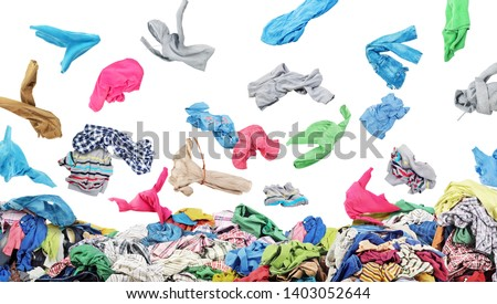 Separate clothing falling at the big pile of clothes on a white background #1403052644
