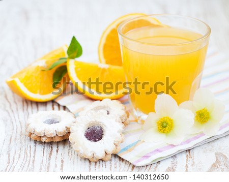 Orange juice, spring blossom and cookies on a wooden background #140312650