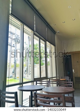 Roll Blinds on the windows, the sun does not penetrate the house. Window in the Interior Roller Blinds. Beautiful Blinds on the Window, the Sun and Heat Protection, the Perfect Windows Interior Decor. #1403233049