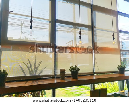 Roll Blinds on the windows, the sun does not penetrate the house. Window in the Interior Roller Blinds. Beautiful Blinds on the Window, the Sun and Heat Protection, the Perfect Windows Interior Decor. #1403233118