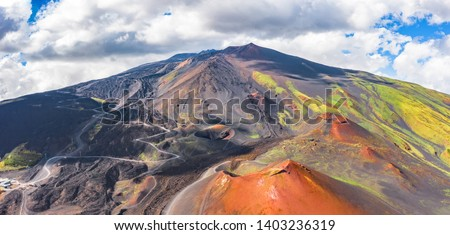 Panoramic wide view of the active volcano Etna, extinct craters on the slope, traces of volcanic activity #1403236319