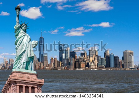 The Statue of Liberty over the Scene of New york cityscape river side which location is lower manhattan,Architecture and building with tourist concept #1403254541