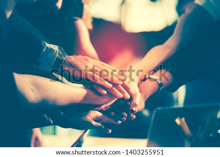 Diversity group of successful business people showing unity with their hands together, Image of businesspeople hands on top of each other as symbol of their partnership. Teamwork agreement concept.  #1403255951