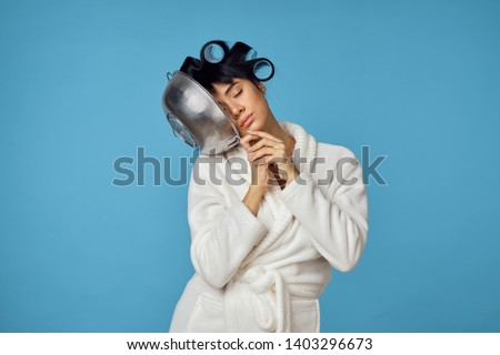 woman with curlers put her head in a colander                              #1403296673