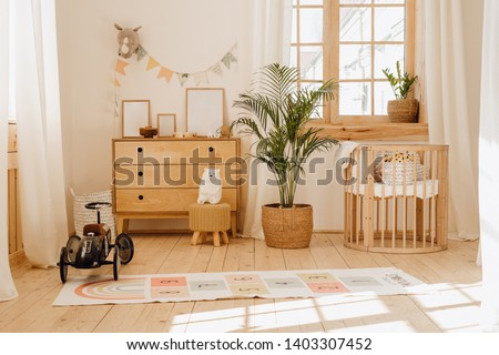 Chalet Baby Bedroom Interior with Cozy Cradle Bed. Light Brown Childish Room with Wooden Empty Cot. Cosy Home Hygge Style Design. Beautiful Child Toy in Large Cottage Background. Modern Eco House #1403307452