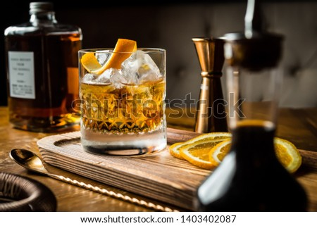 Whisky Old Fashioned served on the rocks with orange Royalty-Free Stock Photo #1403402087