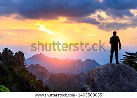 Young happy backpacker on top of a mountain enjoying valley view #1403500055