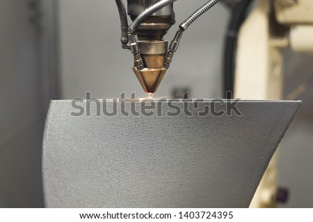 3D metal printer produces a steel part. Revolutionary additive technology for sintering metal parts. Soft focus. #1403724395