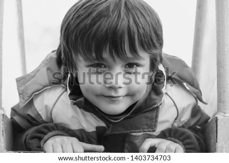 High key light portrait excited kid playing in playground in sunny day summer, Happy Child having fun on playground in kindergarten, Head shot of Cute boy looking at camera with smiling face #1403734703