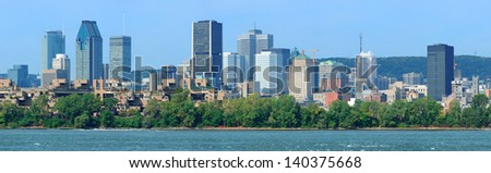 Montreal city skyline panorama over river in the day with urban buildings