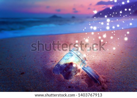 Magical Jar Open On Beach at Night Releasing Star Dust Creative Concept #1403767913