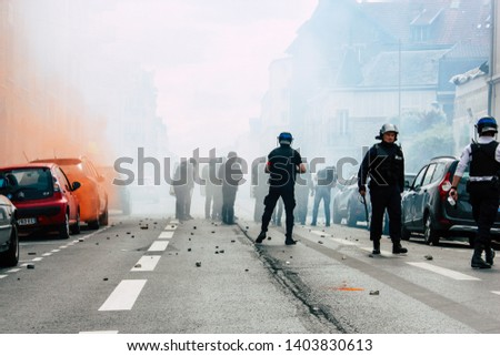 Reims France May 18, 2019 Close up of the French National Police in intervention against the rioters during protests of the Yellow Jackets in the streets of Reims on saturday afternoon #1403830613