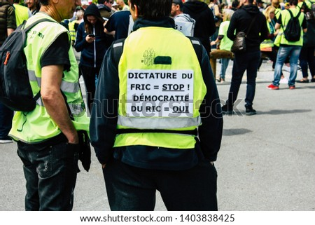 Reims France May 18, 2019 View of unknown Yellow Jackets protesters marching against the policy of President Macron on Saturday afternoon #1403838425
