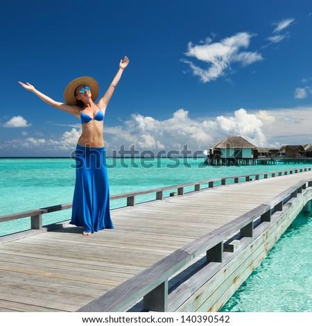Woman on a tropical beach jetty at Maldives #140390542