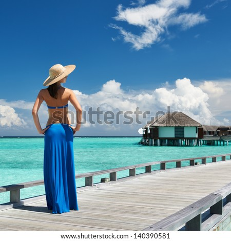 Woman on a tropical beach jetty at Maldives #140390581