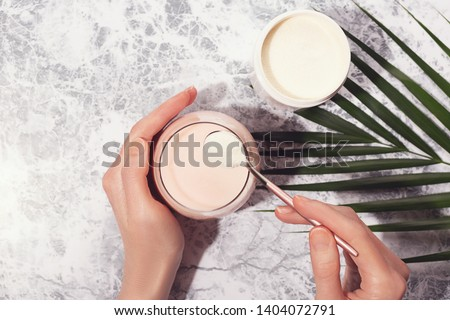 Woman pour collagen powder or protein in morning smoothie or yogurt. Natural beauty and health supplement. Healthy lifestyle. Flatlay, top view. Copy space. #1404072791