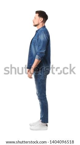Full length portrait of handsome man posing on white background #1404096518
