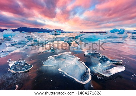 Incredible landscape with icebergs in Jokulsarlon glacial lagoon. Vatnajokull National Park, southeast Iceland, Europe. #1404271826