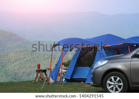 Tent Camping in the Forest. Traveling by Car and Camping with a Tent. Morning landscape with  tent and car, the mountain in the background. Summer camping.  #1404291545