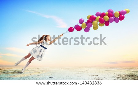 Image of little pretty girl playing with balloons