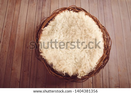 Round basket with white sheepskin rug #1404381356