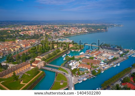 Aerial photography with drone. Beautiful view of the city of Peschiera del Garda, Italy. #1404502280
