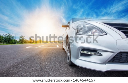 Car traveling in nature on an asphalt road - Front view - Image #1404544157