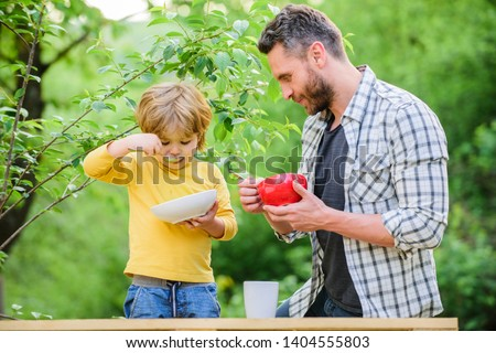 Healthy nutrition concept. Nutrition habits. Family enjoy homemade meal. Personal example. Father teach son eat natural food. Little boy and dad eat. Nutrition kids and adults. Organic nutrition. #1404555803