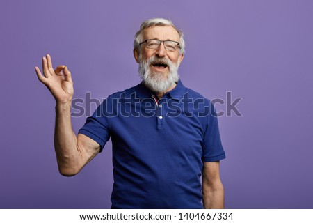 happy positive handsome old man shows Okay sign, no problems, health is Okay everything is okay. close up portrait. isolated blue background. happiness, success concept #1404667334