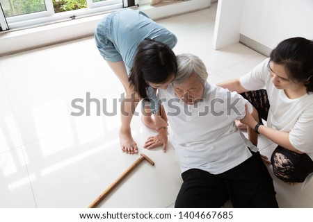 Asian elderly with walking stick on floor after falling down and caring young woman assistant,sick senior or mother fell to the floor because of dizziness and having a daughter,granddaughter to help #1404667685