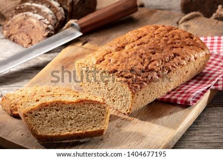 Einkorn wheat bread on cutting board. #1404677195