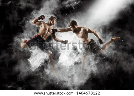 MMA boxers fighters fight in fights without rules.  Smoke background Royalty-Free Stock Photo #1404678122